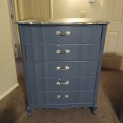A dresser with 5 drawers.