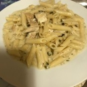 A plate of lemon cream basil pasta with chicken.