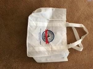 A reusable white shopping bag.
