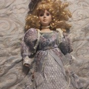 A porcelain doll in an ornate dress.