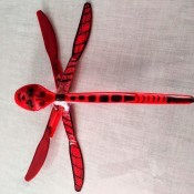 A plastic dragonfly with black markings.