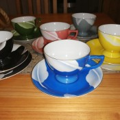 A collection of decorative teacups in different colors.
