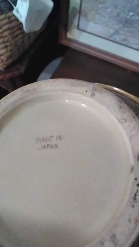 "The bottom of a vase that states ""Made in Japan"""