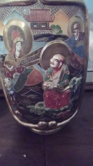 The side of a decorative Japanese vase.
