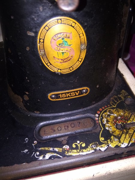 The markings on an old sewing machine.