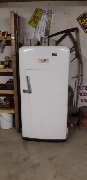 An old white refrigerator.