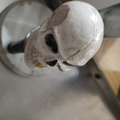 A stick shift knob that resembles a skull.