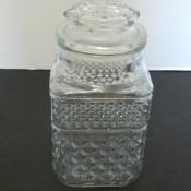 A square glass patterned jar.