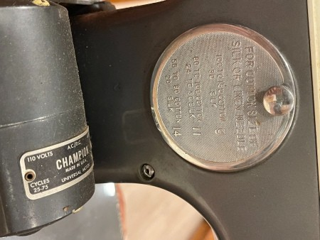 A metal label on a sewing machine.