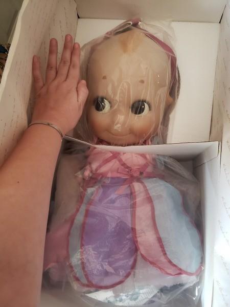 A Kewpie doll still in the packaging.