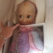 A Kewpie doll still in the packaging.