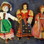 Several different dolls in traditional costumes.