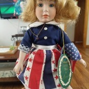 A doll with red, white and blue clothing.