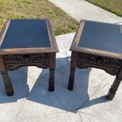 A pair of leather topped tables.