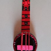 A mini banjo made from recycled materials.