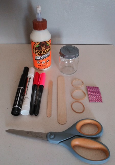 Supplies for making a mini love banjo.