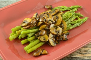 Asparagus with mushrooms on a plate.