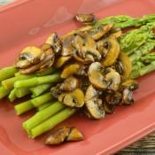 Asparagus with mushrooms on a plate.