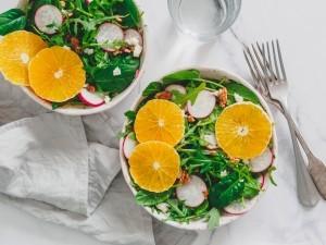 Salads with orange slices.
