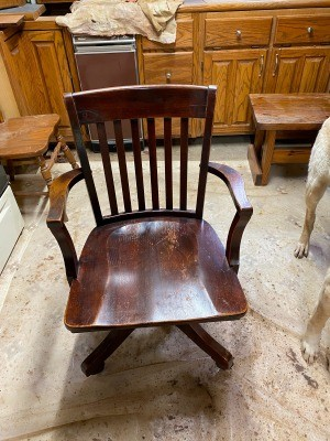 A wooden office chair.