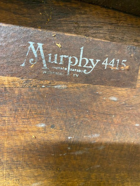 The Murphy marking on the underside of a chair.
