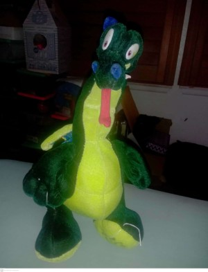 A green dragon with a long tongue.