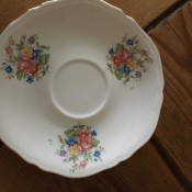 A floral pattern on a china saucer.