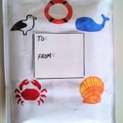 A decorated bubble mailer with designs from the sea.