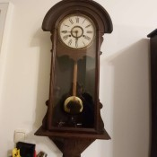 A vintage wooden wall clock.