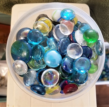 A container of glass marbles.