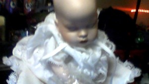 A porcelain baby doll.