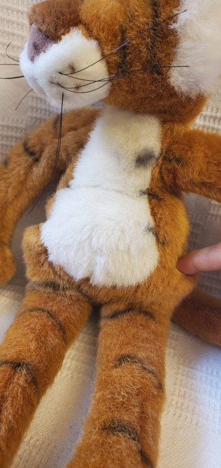 The belly of a stuffed tiger.