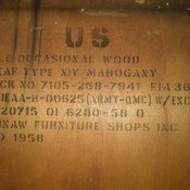 Information stamped on the underside of a table.
