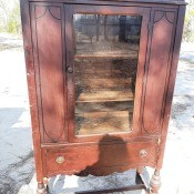A wooden china cabinet.