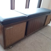 A console bench with a stereo inside.