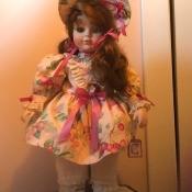 A porcelain doll in a modern dress.