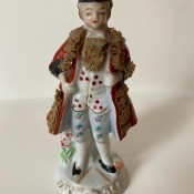 An old fashioned figurine of man or boy.