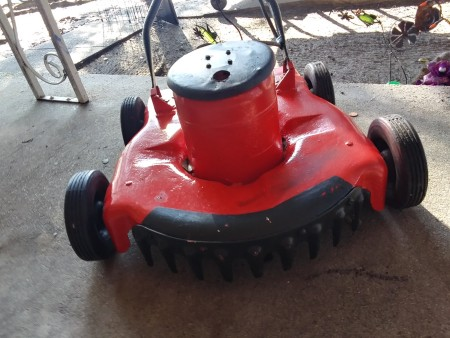 A red lawnmower.