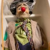 An Emmett Kelly doll still in the packaging.
