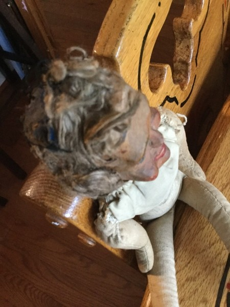 A top view of an old doll.