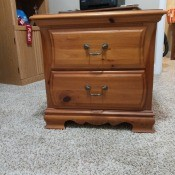 A small wooden nightstand.