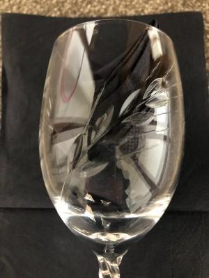 A close up of a cut design on glassware.