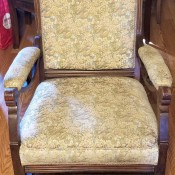 A wooden upholstered chair.