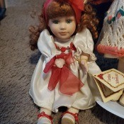 A porcelain doll with reddish hair.