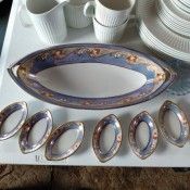 A large china platter with small matching dishes.