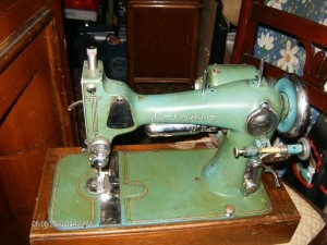 An old green colored sewing machine.