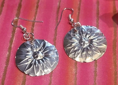 Two completed flower earrings.