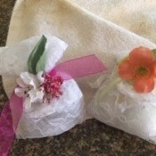 Two completed sachets with decorative flowers.