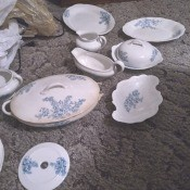 A set of white china with blue flowers.