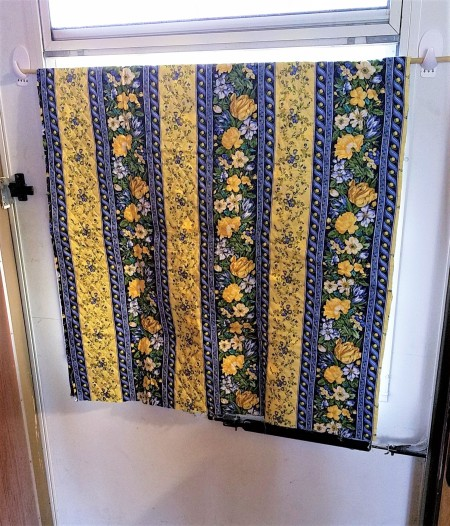 A window covered with colorful fabric.